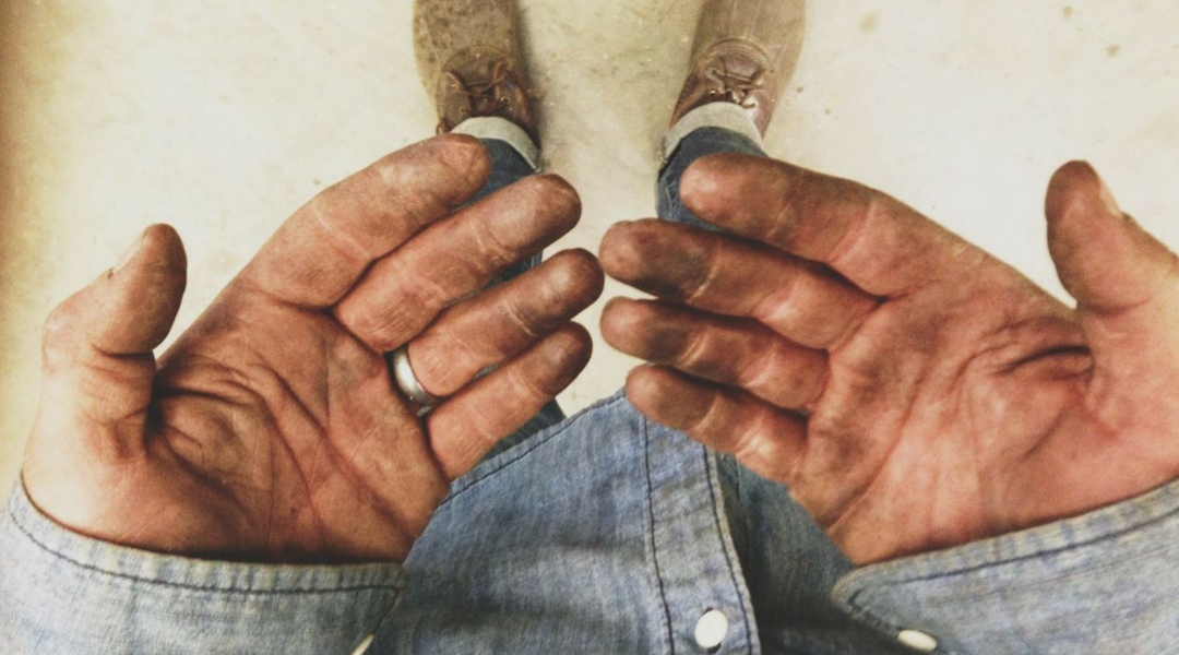 Working hands that are dirty from building capacity first